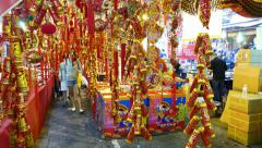 Traditional chinese new year decoration store at market, closeup view to bangles Stock Footage