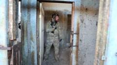 Antiterrorism training men clearing rooms - stock footage