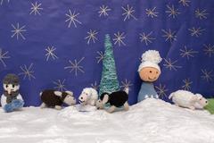 Xmas decorations crafts snow scenary crochet snowman, boy, sheep and tree - stock photo