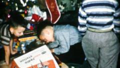 Boys Playing With Christmas Train Set-1956 Vintage 8mm film Stock Footage