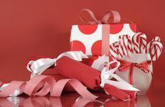 Stack of bright red and white polka dot and check festive Christmas gift boxe - stock photo