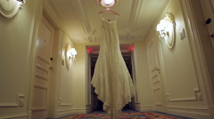 The bride's dress hangs on a hanger in the hall. Stock Footage