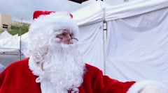Santa Claus giving Christmas greetings to children Stock Footage