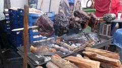 Meat roasting on an open fire Stock Footage