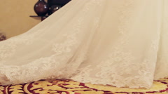 Long plume of the bride dress stretches the carpet. - stock footage
