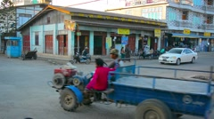 People and transport traffic on big village cross road Stock Footage