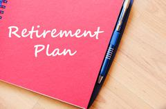 Retirement plan write on notebook - stock photo