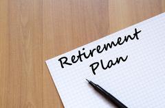 Retirement plan write on notebook Stock Photos