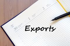 Exports write on notebook - stock photo