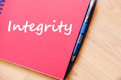 Integrity write on notebook - stock photo