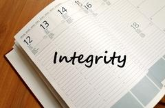 Integrity write on notebook Stock Photos