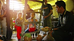 Guide tell about the traditional malay production of rice wine to tourist gro Stock Footage