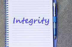 Stock Photo of Integrity write on notebook