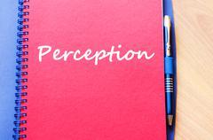 Perception write on notebook Stock Photos