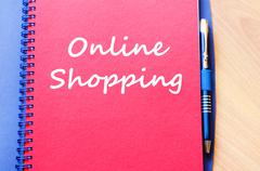 Online shopping write on notebook - stock photo