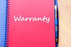 Warranty write on notebook - stock photo