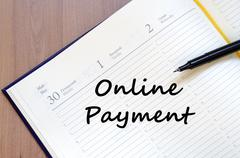 Online payment write on notebook Stock Photos