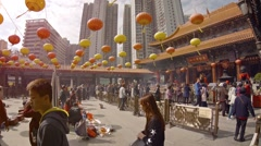 Colorful paper lanterns at Wong Tai Sin Buddhist temple in Hong Kong Stock Footage