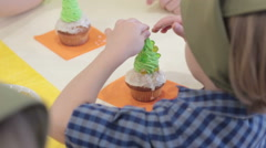 Cupcakes little boy decorate with sprinkles muffin Stock Footage