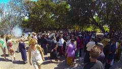 Tourists and mourners gather to pay respects at a Hindu cremation ceremony Stock Footage