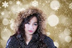 Stock Photo of Girl with winter coat and defocused background