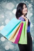 Lovely shopper with winter background - stock photo