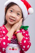 Young Girl in Christmas Costume with Santa Claus Hat Kuvituskuvat