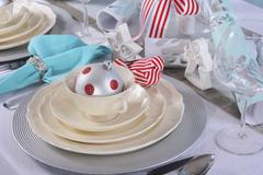 Aqua, red and white Christmas table setting. - stock photo