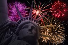 The Statue of Liberty with colorful fireworks Stock Photos