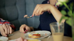 Couple eating breakfast in the cafe and girl feeding his boyfriend, steadycam sh Arkistovideo