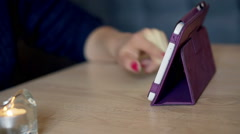 View of female hands typing something on tablet in the cafe Stock Footage