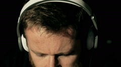 Man having his eyes closed and listening music on headphones, steadycam shot Stock Footage