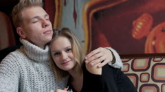 Couple cuddling in the cafe and girl smiling to the camera - stock footage