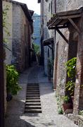 Wonderful street in small medieval town in sunny day - stock photo