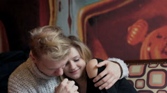 Couple cuddling and holding each other hands in the cafe, steadycam shot - stock footage