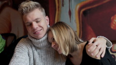Couple cuddling in the cafe and boy smiling to the camera - stock footage