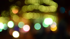 defocused holiday christmas lights in the city - stock footage