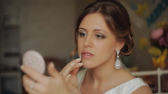 portrait of bride putting on make-up - stock footage