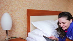 Woman with the tablet on the double bed Stock Footage