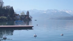 Stock Video Footage of Boat & Dock with View of Swiss Alps