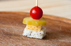 Canape with salted lard, bread, cherry tomato and pickled cucumber Stock Photos