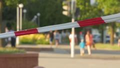 Ungraded: Red-White Cauntion Tape in City Stock Footage