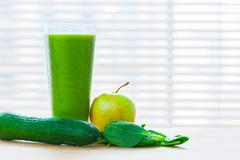 Fresh juice from green vegetables and fruits. Healthy vitamin drink. Stock Photos