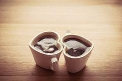 Black coffee, espresso in two heart shaped cups. Love concept, Valentine' - stock photo