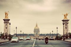Les Invalides seen from Pont Alexandre III bridge in Paris, France. Vintage - stock photo