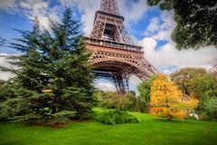 Eiffel Tower from Champ de Mars park in Paris, France - stock photo