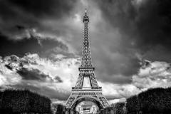 Eiffel Tower seen from Champ de Mars park in Paris, France. Black and white - stock photo