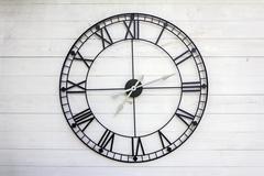 Old roman numeral clock - stock photo
