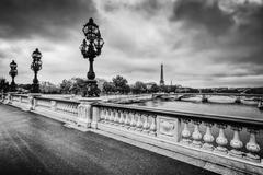 Pont Alexandre III bridge in Paris, France. Seine river and Eiffel Tower. - stock photo