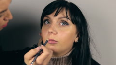 Professional face makeup on lips  for photo shooting Stock Footage
